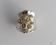 Silver & 18ct ring with yellow Sapphires