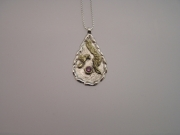 Silver & 18ct gold pendant with pink Sapphire