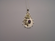 Silver & 18ct gold pendant with deep red Sapphire