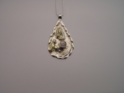 Silver & 18ct gold pendant with very pale lilac Sapphire