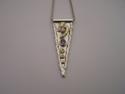 Silver & 18ct gold pendant with one Tanzanite and 2 Diamonds